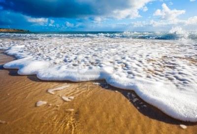 14116268-waves-wash-over-golden-sand-on-australian-beach