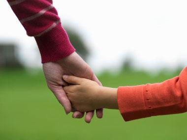 01 child-holding-hand