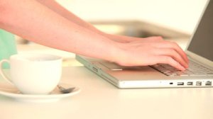01 stock-footage-woman-working-on-her-laptop-in-the-kitchen
